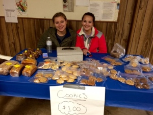 Karleigh Ashbaugh and Brittany Sample sold baked goods as part of a recent softball team fundraiser at the Saegertown Sportsmen's Club.
