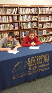 Dylan Reynolds and Tyler Vath signed commitments to D1 wrestling programs at Clarion and Edinboro respectively on Dec. 2 in the Saegertown High School Iibraries. (photo by Casey Fetzner)