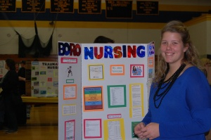 Jess Tomiczek stands with her trifold at Senior Showcase Night.  (SHS/Lindsey Price)