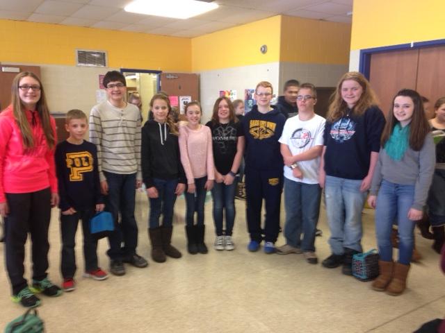 From left: seventh graders _____ to Luchansky. (Lauren Haylett/SHS)