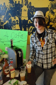 Freshman Francis Jageacks poses with her cafe sign (Photo by Casey Fetzner).