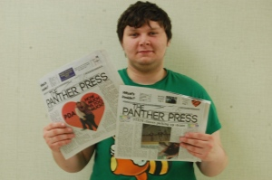 Woge poses with two copies of The Panther Press with the new header. (photo contributed)
