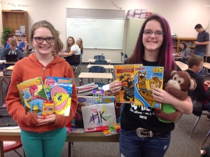 Meadow Campbell and Samantha Evans hold donated items. (photo contributed)
