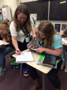 Mrs. Norwood helping a student in her classroom.
