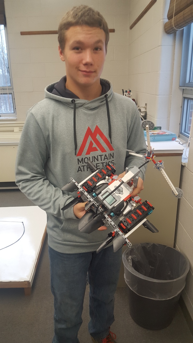 Ethan Hayes shows off his robot he built in Mr. Patrick's robotics class.